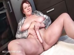 Redhead mature masturbating with dildo..