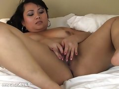Asian thea masturbating her shaved pussy